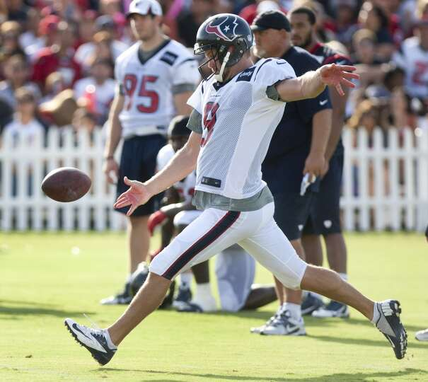 Punter Shane Lechler winds up to punt.
