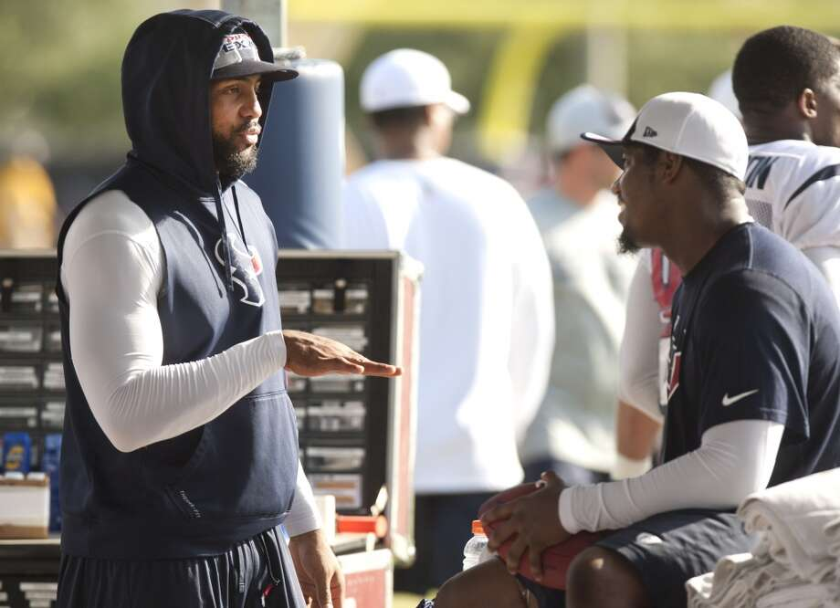 Running back Arian Foster, left, and Houston Texans running back Ben Tate talk inside the training area of the practice field. Photo: Brett Coomer, Chronicle