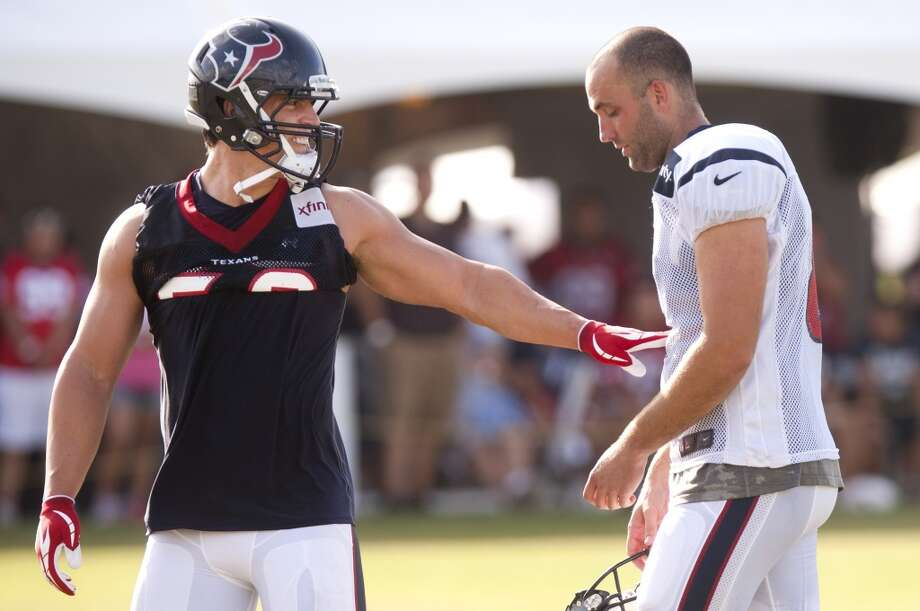 Inside linebacker Brian Cushing (56) walks past Matt Schaub (8) at the beginning of 7-on-7 drills. Photo: Brett Coomer, Chronicle