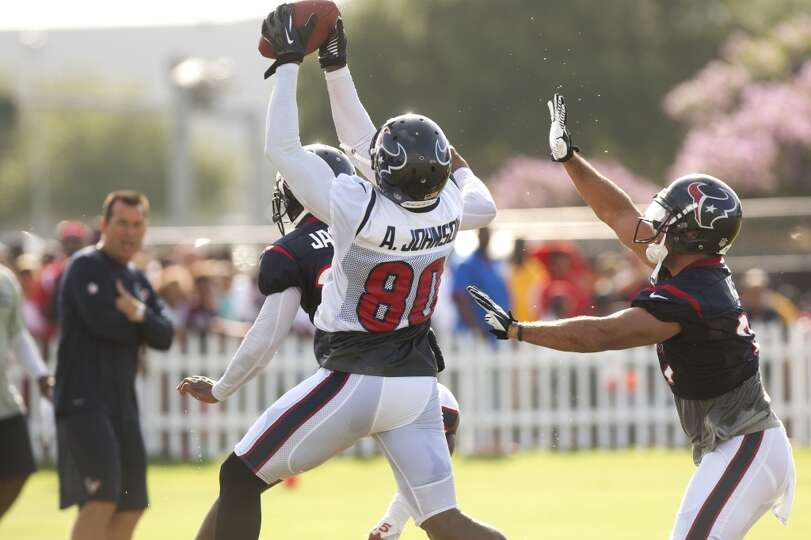 Wide receiver Andre Johnson (80) makes a catch in the end zone over defensive backs Kareem Jackson (