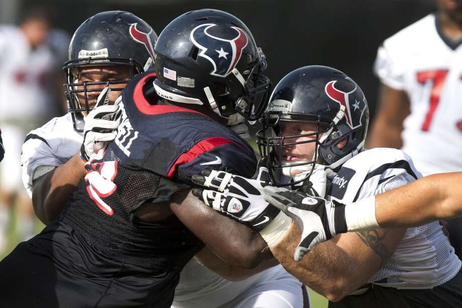 Guard Brandon Brooks, left, and Houston Texans center Chris Myers, right, double-team nose tackle Earl Mitchell (92). Photo: Brett Coomer, Chronicle