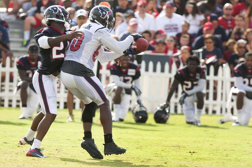 Wide receiver Andre Johnson (80) makes a catch with cornerback Johnathan Joseph (24) defending.