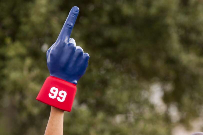 A fan holds up a giant No. 1 finger.