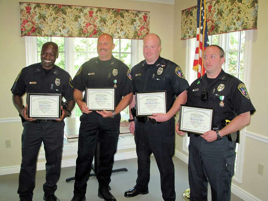 From left: Officers Rex Sprosta, Scott Humberg, Michael O'Sullivan and Daniel Gulino. The officers received awards for their service Frida morning, Aug.2 at a ceremony at the Lapham Center in New Canaan. Photo: Tyler Woods
