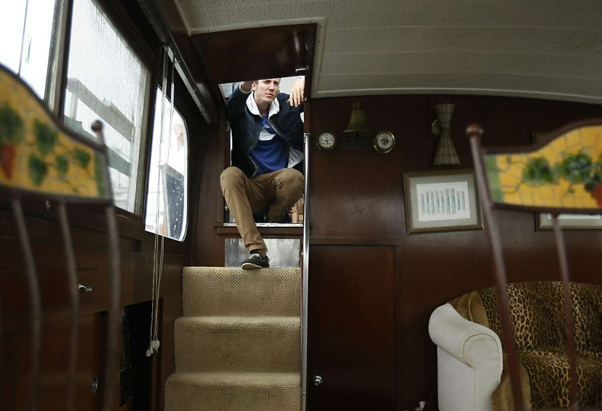 Boatbound Co-founder Matt Johnston sits atop the stairs of the hold on board the Peaceful Warrior. Uber and Boatbound teamed up to provide a worker commute service to San Francisco in the event of a BART strike on Monday, August 05, 2013 from Oakland, Calif.