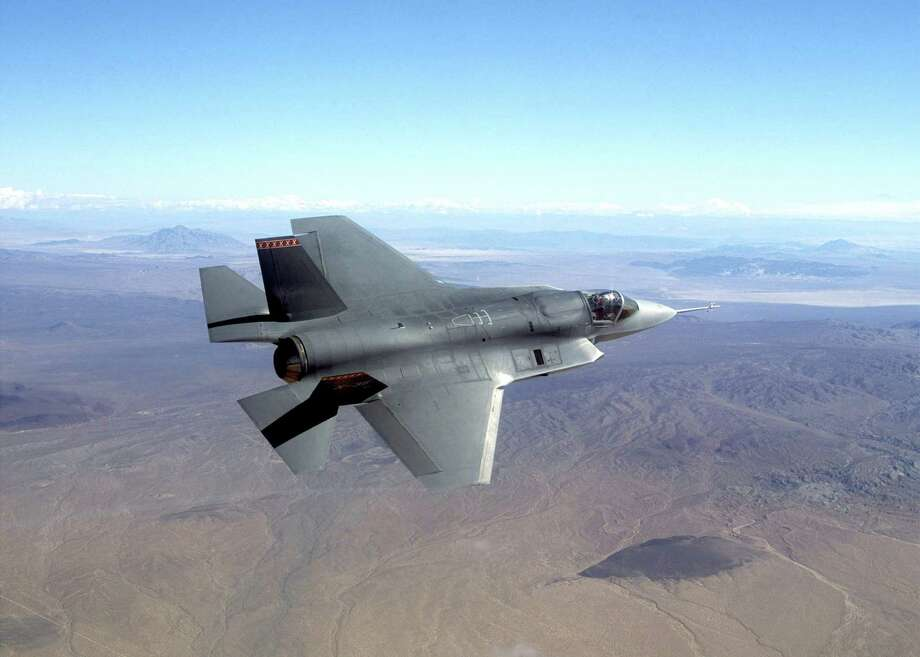 FILE -This undated photo provided by Northrop Grumman Corp., shows a pre-production model of the F-35 Joint Strike Fighter.  The Pentagon on Friday grounded its fleet of F-35 fighter jets after discovering a cracked engine blade in one plane. The problem was discovered during what the Pentagon called a routine inspection at Edwards Air Force Base, California, of an F-35A, the Air Force version of the sleek new plane. The Navy and the Marine Corps are buying other versions of the F-35, which is intended to replace older fighters like the Air Force F-16 and the Navy F/A-18. All versions , a total of 51 planes , were grounded Friday, Feb. 22, 2013 pending a more in-depth evaluation of the problem discovered at Edwards. None of the planes have been fielded for combat operations; all are undergoing testing.AP Photo/Northrop Grumman, File)  no sales Photo: Anonymous / NORTHROP GRUMMAN
