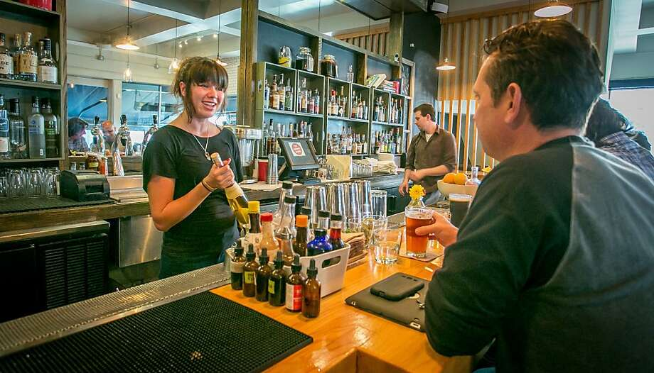 Bartender Nicole McFeely talks with a customer at the Corner Store in San Francisco, Calif., on Thursday, August 1st, 2013. Photo: John Storey, Special To The Chronicle