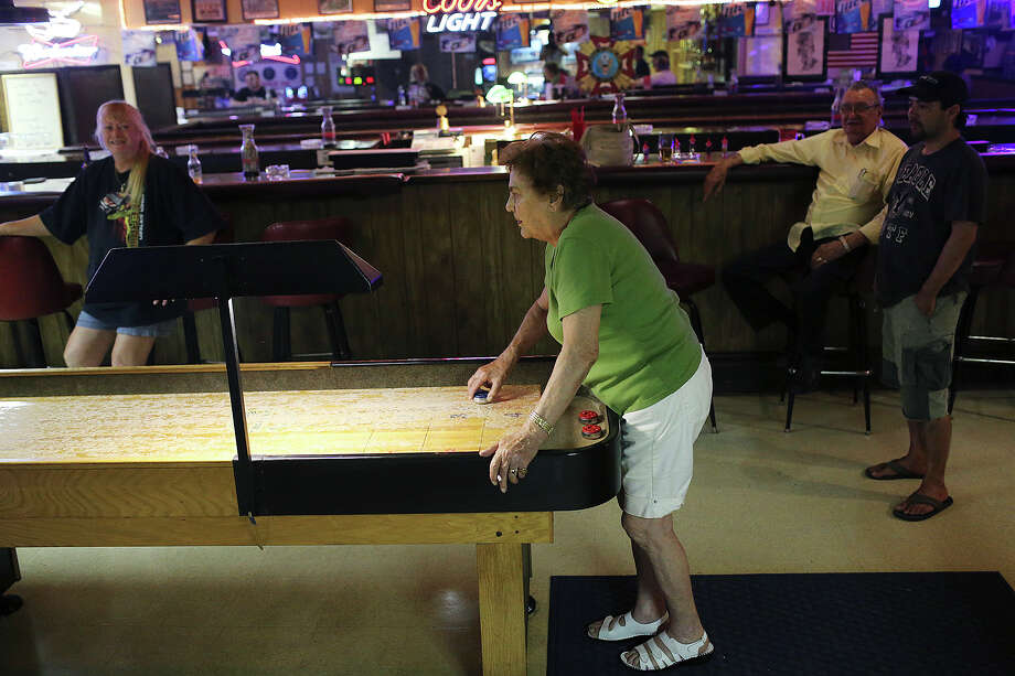 Barbara Gee, 81, enjoys a game of shuffleboard at the Veterans of Foreign Wars Post 9192 in Killeen, Texas Sunday, August 4, 2013. On Tuesday, U.S. Army Maj. Nidal Malik Hasan will go on trial on capital murder in the death of 13 people during a shooting rampage at Fort Hood on Nov. 5, 2009. On that day, Gee was shopping at the installation's commissary with friend, Mary Williamson, left. They were on lockdown at the store for five hours. She wasn't aware of the shootings until she received a phone call from a friend in Germany. Both agreed that the proceeding have dragged on too long and are looking forward to the conviction of Hasan. Photo: San Antonio Express-News / ©2013 San Antonio Express-News
