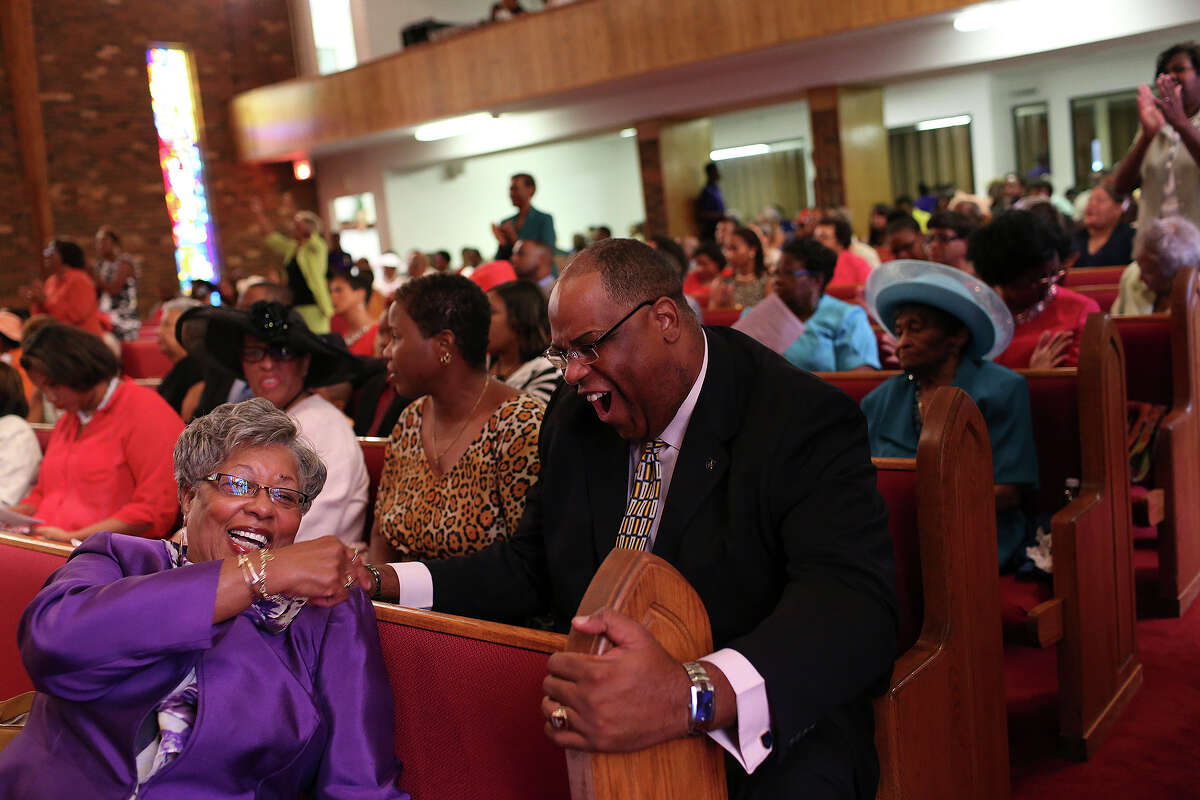 Phillis Morrison, the wife of pastor Rev. David L. Morrison, Sr., laughs with Alonzo Lunsford at St. Luke AME Church in Fayetteville, NC on Sunday, July 21, 2013.