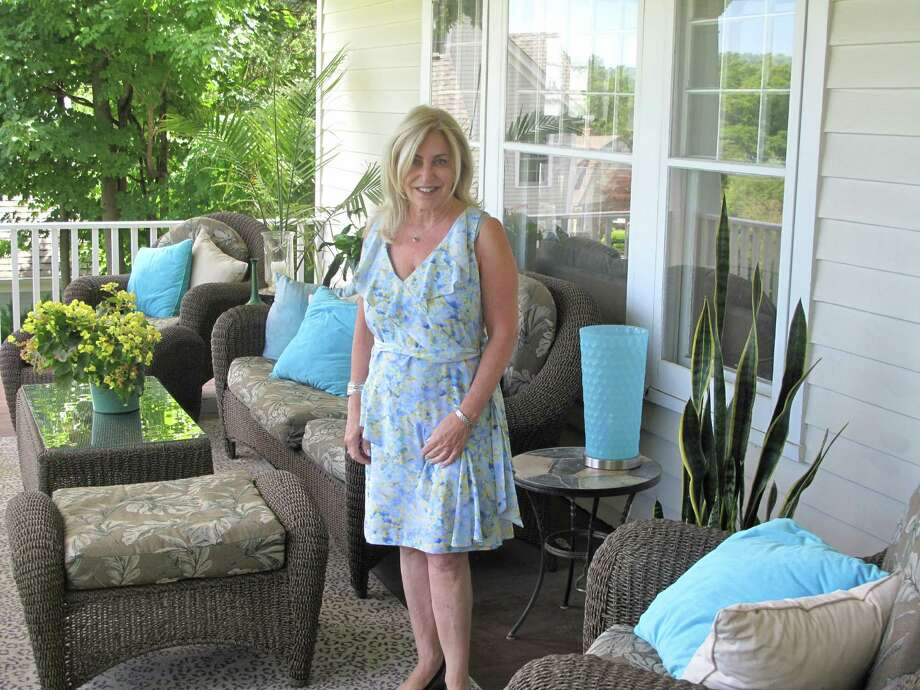Denise Gannalo on her porch at 275 Main Street, New Canaan. The porch serves as a gathering spot for family and friends on Memorial Day. Photo: Tyler Woods