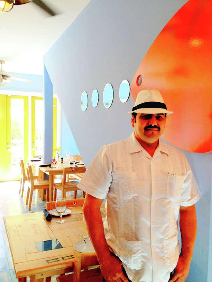 Servers at La Fisheria in Houston wear a staff uniform of linen Guayabera shirts and Panama hats. Photo: La Fisheria / La Fisheria