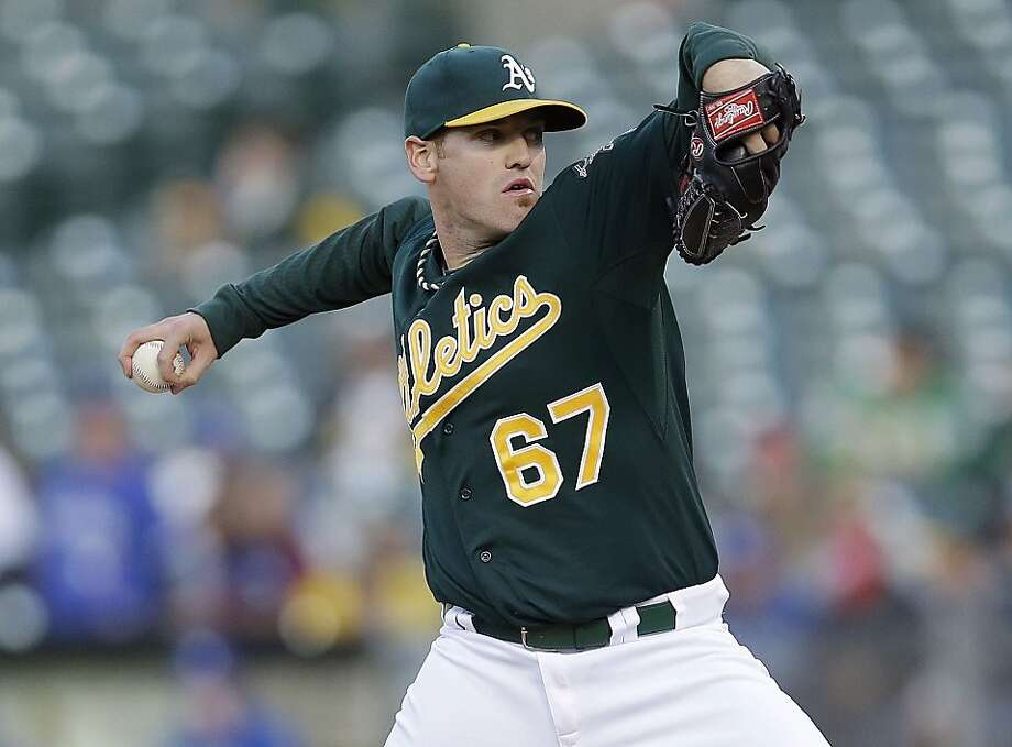 Oakland Athletics starting pitcher Dan Straily throws to the Toronto Blue Jays during the third inning of a baseball game Tuesday, July 30, 2013, in Oakland, Calif. (AP Photo/Marcio Jose Sanchez) Photo: Marcio Jose Sanchez, Associated Press