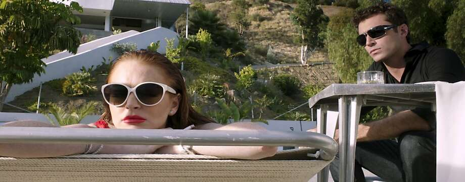 """Lindsay Lohan and James Deen in the film """"Canyons."""" The erotic thriller is directed by Paul Schrad and written by Bret Easton Ellis. Photo: Ifc Films, New York Times"""