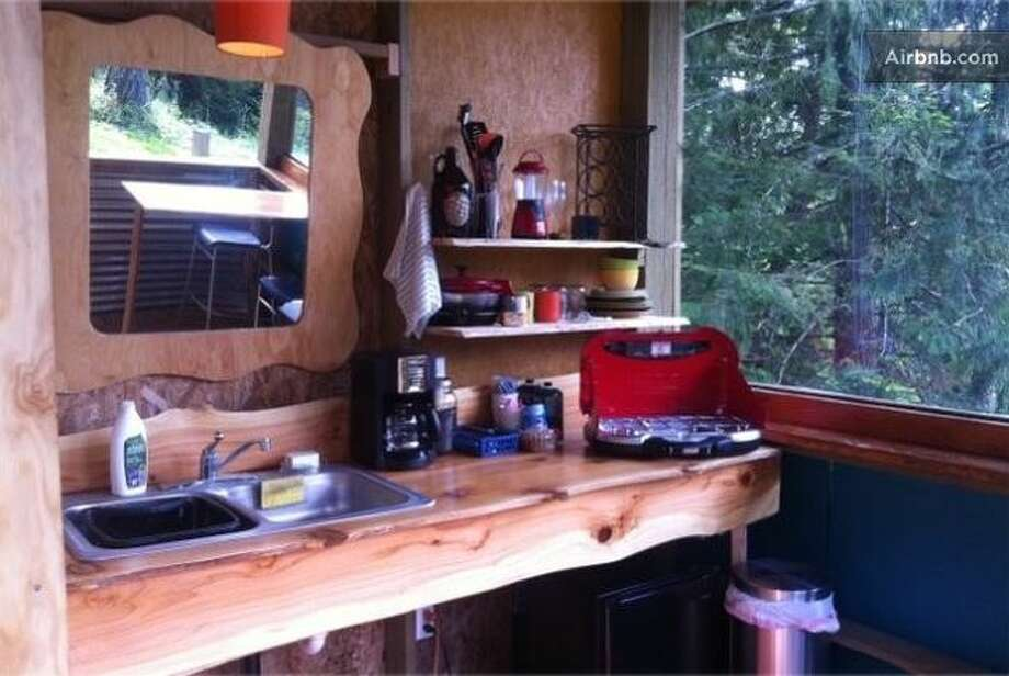 """The """"glamping"""" rental includes access to a nearby outdoor  kitchen, which has a sink with running water, coffee maker, fridge and camping stove. Guests can fill up growlers from an """"honor keg"""" of local microbrew.  Photo: Ho, Vanessa, Airbnb"""