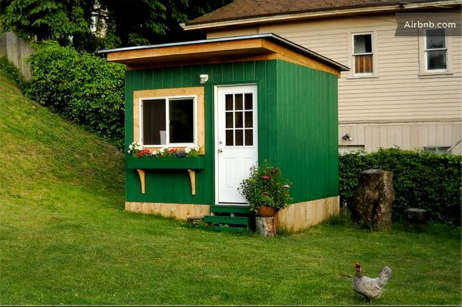 """""""Tiny garden cabin"""" in SeattleLocated in the same backyard as the """"Gypsy wagon"""" is the """"Tiny garden cabin""""  in Queen Anne. """"This cabin was built with Airbnb in mind,"""" writes owner Jean-Marc in his Airbnb listing. It's got cherry hardwood floors  and includes Wi-Fi, heat, microwave and mini-fridge. Photo: Ho,  Vanessa, Airbnb"""