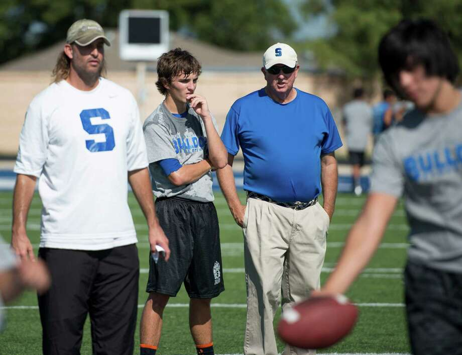 Somerset head coach Sonny Detmer, right, talks to his grandson, quarterback Koy Detmer, Jr., center, as coach Koy Detmer, Sr., works with players during football practice, Monday, August 5, 2013, at Somerset High School in Somerset, Texas. (Darren Abate/For the Express-News) Photo: Darren Abate, Darren Abate/Express-News