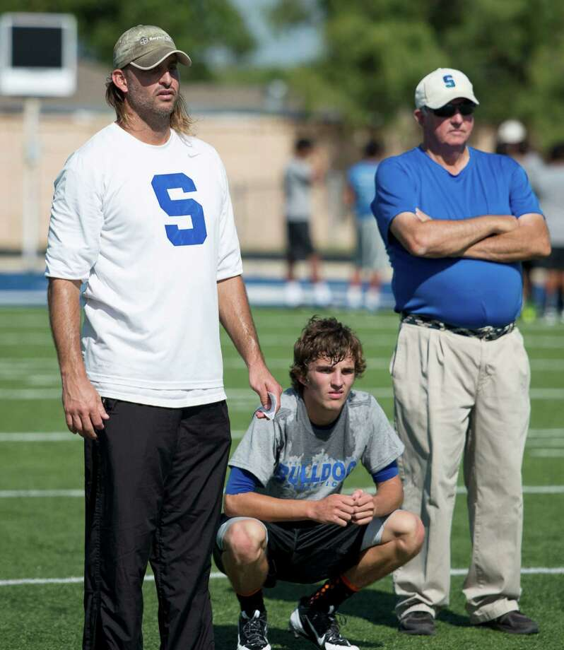 Somerset coach Koy Detmer, Sr. (from left), quarterback Koy Detmer, Jr., and head coach Sonny Detmer, watch players perform drills during football practice, Monday, August 5, 2013, at Somerset High School in Somerset, Texas. (Darren Abate/For the Express-News) Photo: Darren Abate, Darren Abate/Express-News