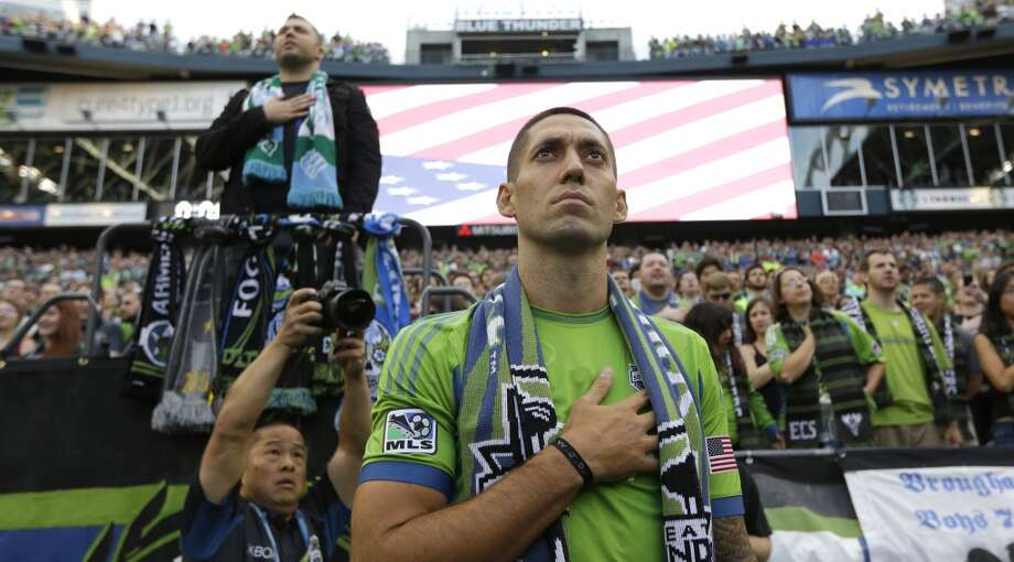 Clint Dempsey stands for the singing of the National Anthem after he was introduced as the newest member of the Sounders on Saturday. Photo: Ted S. Warren, Associated Press