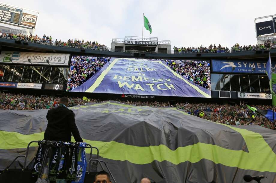A tifo -- the large fabric signs displayed at soccer matches -- that reads ''Keep Calm #DempseyWatch'' is displayed after Clint Dempsey was introduced as the newest member of the Sounders on Saturday. Photo: Ted S. Warren, Associated Press