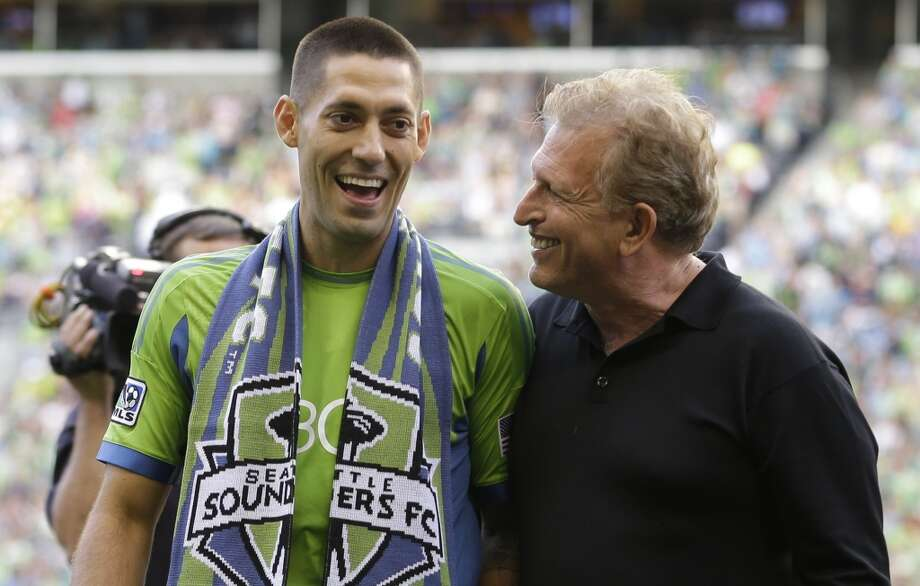 Clint Dempsey, left, is introduced as the newest member of the Sounders by majority owner Joe Roth, right, on Saturday. Photo: Ted S. Warren, Associated Press