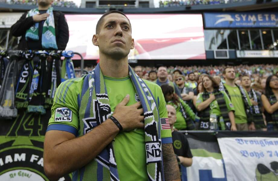 Clint Dempsey stands for the National Anthem after he was introduced as the newest member of the Sounders on Saturday. Photo: Ted S. Warren, Associated Press