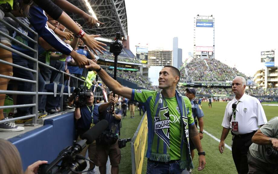 Clint Dempsey greets fans after he was introduced as the newest member of the Sounders on Saturday. Photo: Ted S. Warren, Associated Press