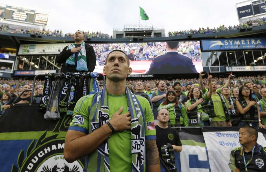 Seattle Sounders' Clint Dempsey stands in front of the Seattle Sounders supporters section during the singing of the National Anthem after he was introduced as the newest member of the MLS soccer team on Saturday. Photo: Ted S. Warren, ASSOCIATED PRESS