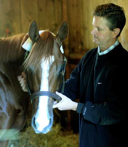 Lea stands in his stall with his trainer Al Stall Aug. 5, 2013, at Saratoga Race Course in Saratoga Springs, N.Y. Lea will attempt to beat Wise Dan on Saturday. (Skip Dickstein/Times Union) Photo: SKIP DICKSTEIN