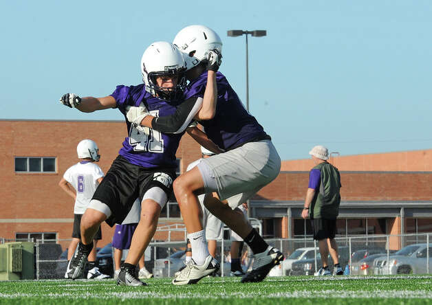 Port Neches-Groves Indians run drills during the season's first day of practice at the Reservation on Monday. Photo taken Monday, Aug 05, 2013 Guiseppe Barranco/The Enterprise Photo: Guiseppe Barranco, STAFF PHOTOGRAPHER / The Beaumont Enterprise