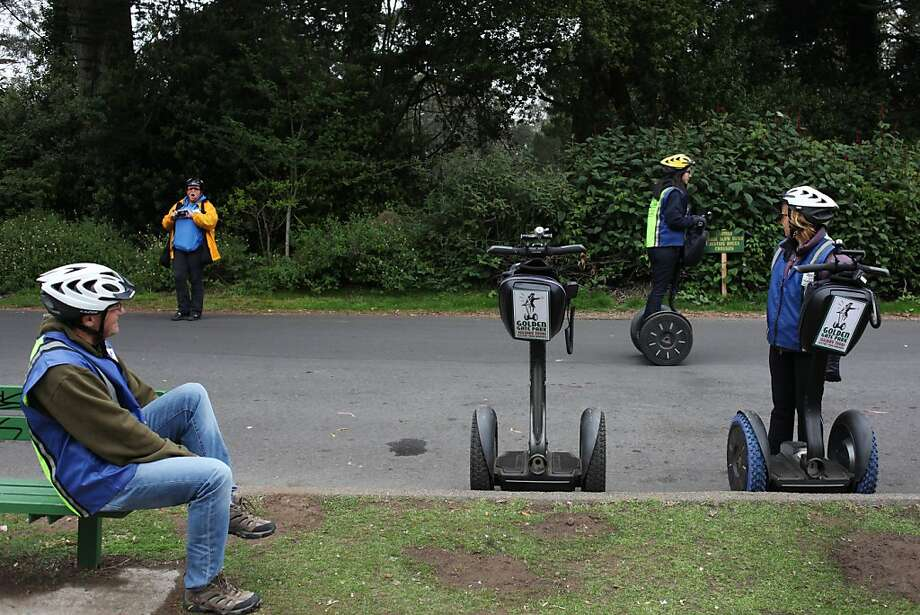 A group touring the park on Segways pauses on Stow Lake Drive, near the base of Strawberry Hill. Photo: Pete Kiehart, The Chronicle