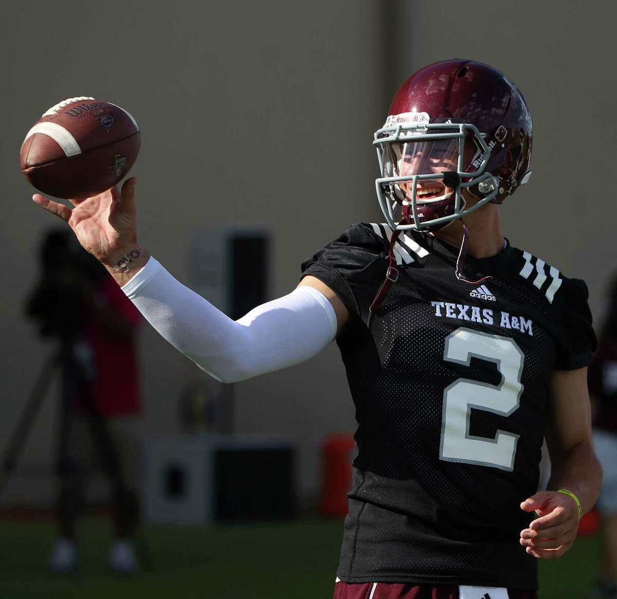 Texas A&M quarterback Johnny Manziel (2) prepares to make a throw during Texas A&M's first workout, Monday, Aug. 5, 2013, in College Station.