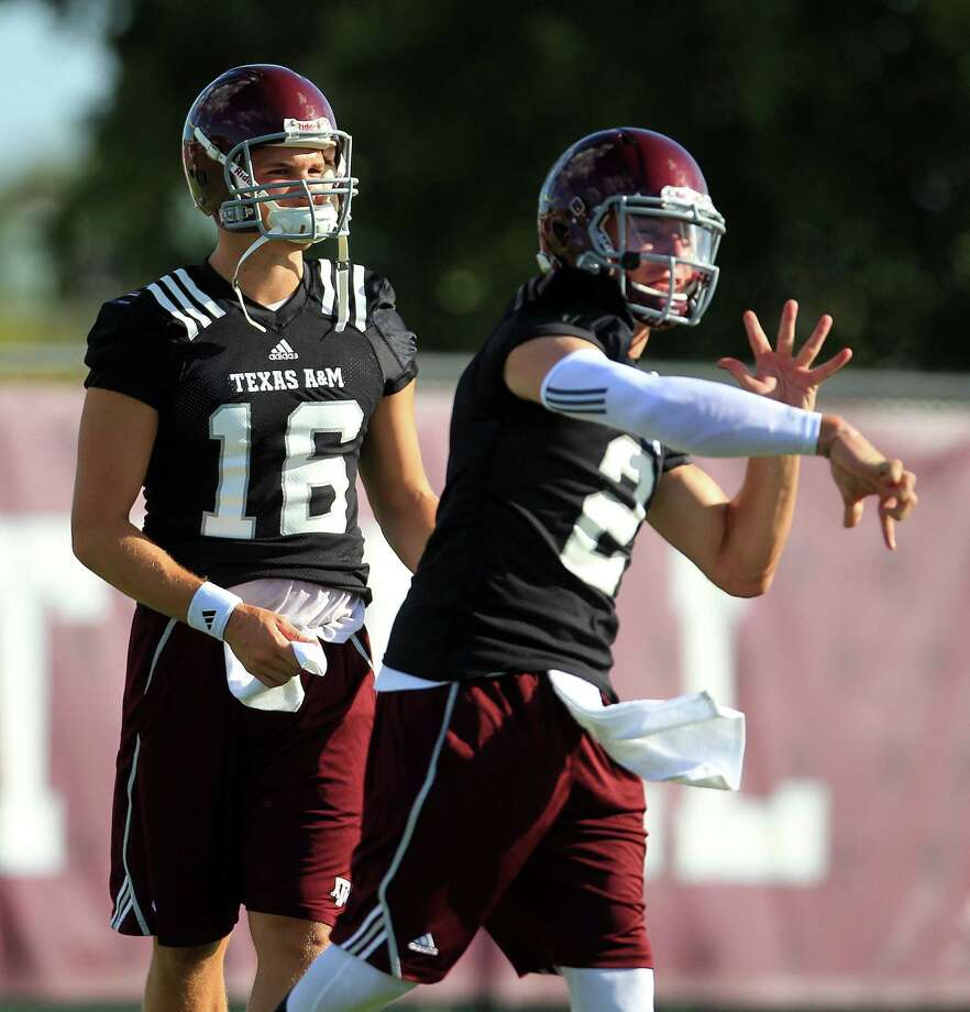 Texas A&M backup QB Matt Joeckel (16) watches Johnny Manziel (2) throw during Texas A&M's first workout, Monday, Aug. 5, 2013, in College Station. Photo: Karen Warren, Houston Chronicle / © 2013 Houston Chronicle