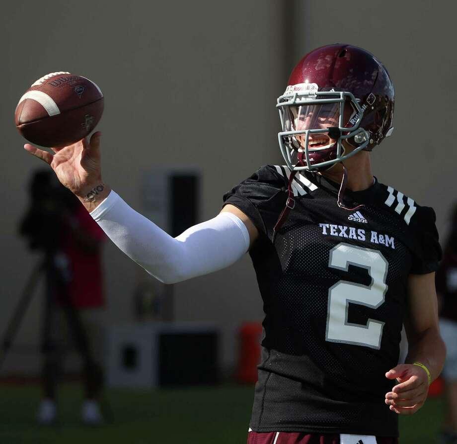 Texas A&M quarterback Johnny Manziel (2) prepares to make a throw during Texas A&M's first workout, Monday, Aug. 5, 2013, in College Station. Photo: Karen Warren, Houston Chronicle / © 2013 Houston Chronicle