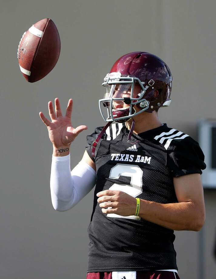 Texas A&M quarterback Johnny Manziel (2) prepares to make a throw during Texas A&M's first workout, Monday, Aug. 5, 2013, in College Station. Photo: Karen Warren, Houston Chronicle / © 2013 Houston Chronicle