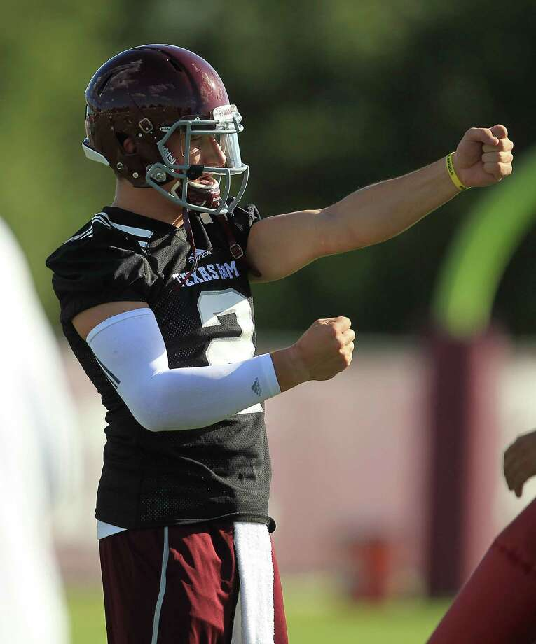 Texas A&M quarterback Johnny Manziel (2) gestures during Texas A&M's first workout, Monday, Aug. 5, 2013, in College Station. Photo: Karen Warren, Houston Chronicle / © 2013 Houston Chronicle