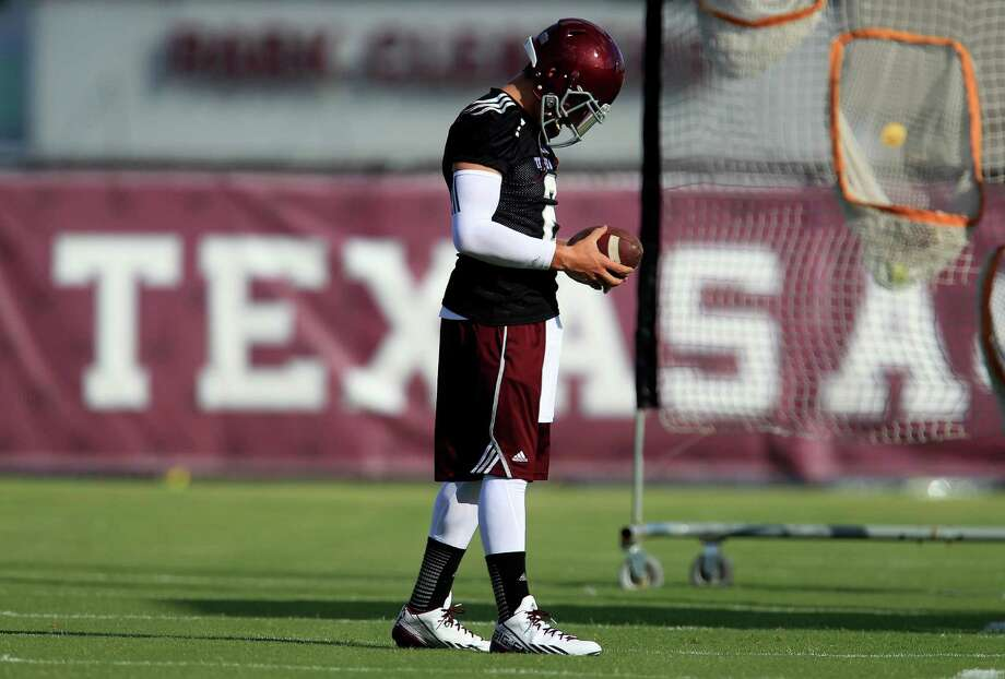 Texas A&M quarterback Johnny Manziel (2) during a drill during Texas A&M's first workout, Monday, Aug. 5, 2013, in College Station. Photo: Karen Warren, Houston Chronicle / © 2013 Houston Chronicle