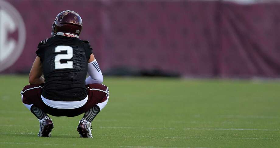 Texas A&M quarterback Johnny Manziel (2) takes a break during a drill during Texas A&M's first workout, Monday, Aug. 5, 2013, in College Station. Photo: Karen Warren, Houston Chronicle / © 2013 Houston Chronicle