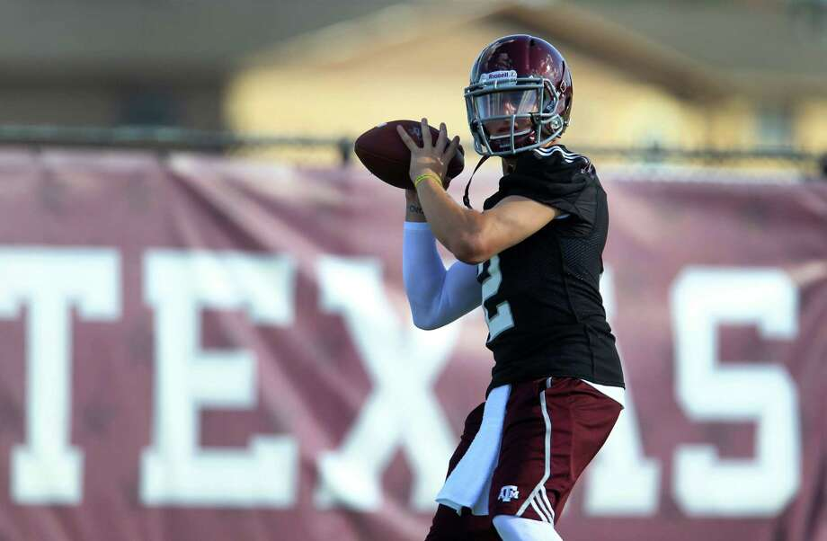 Texas A&M quarterback Johnny Manziel (2) throws the ball during a drill during Texas A&M's first workout, Monday, Aug. 5, 2013, in College Station. Photo: Karen Warren, Houston Chronicle / © 2013 Houston Chronicle