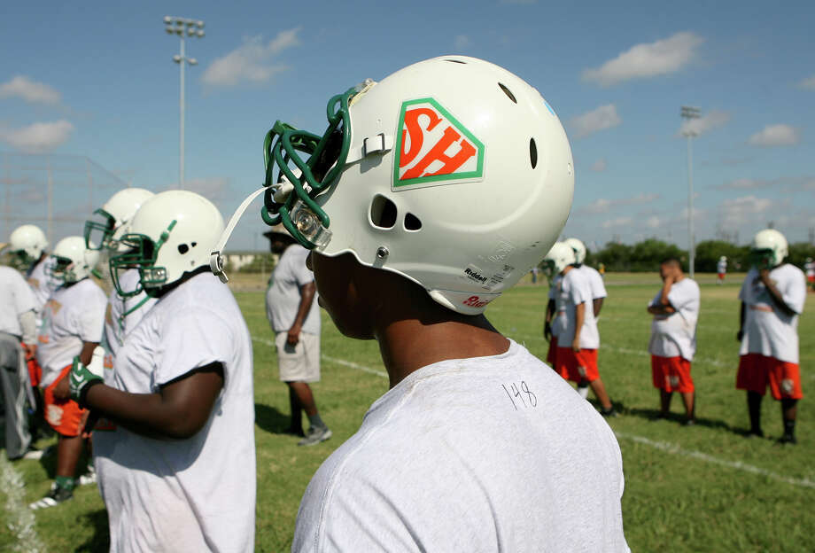 The Sam Houston High School football team begins practices Monday, Aug. 5, 2013 for the 2013 football season. They practiced for three hours with many water breaks and will do so for the rest of the week. Photo: Cynthia Esparza, For San Antonio Express-News / For San Antonio Express-News