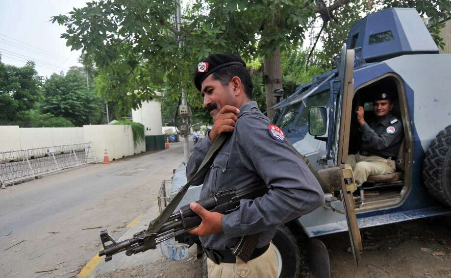 Security personnel keep vigil Monday outside the U.S. Consulate in Lahore, Pakistan. Diplomatic missions in Pakistan were open despite the al-Qaida threat. Photo: ARIF ALI, Stringer / AFP
