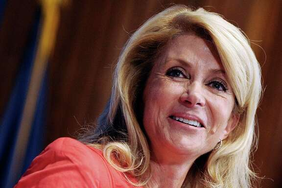 """I will run for two offices - either my state Senate seat or the governor,"" state Sen. Wendy Davis said Monday at the National Press Club luncheon in Washington, D.C."
