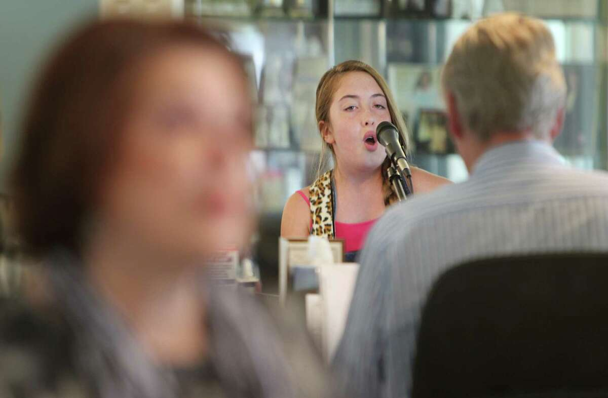 Collette Bruhn, 12, sings for voice coach Tom McKinney and his wife Colleen McKinney, who are Houston based voice teachers, who know what it takes to develop one's talents on Wednesday, July 31, 2013, in Houston.