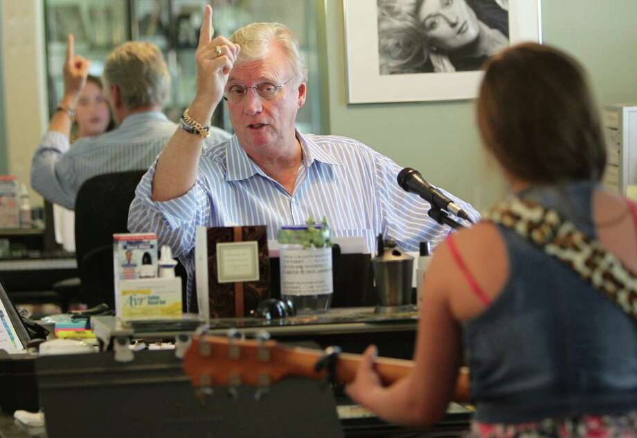"Voice coach Tom McKinney instructs young country singer Collette Bruhn, 12, during a voice session on Wednesday, July 31, 2013, in Houston.  Tom McKinney's students include contestants on TV's ""American Idol"" and ""The Sing-Off"" and he knows what it takes to develop one's talents. Photo: Mayra Beltran, Houston Chronicle / © 2013 Houston Chronicle"