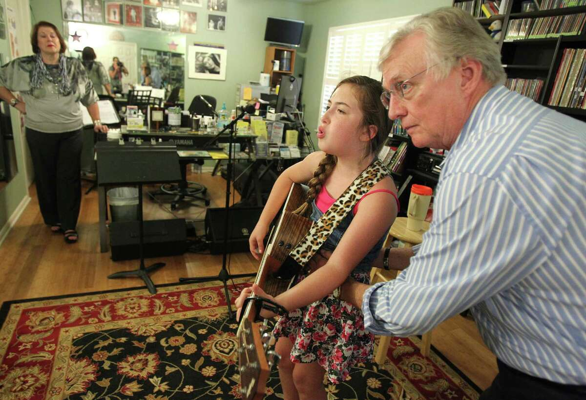 Voice coach Tom McKinney instructs young country singer Collette Bruhn, 12, how to project her voice on Wednesday, July 31, 2013, in Houston. Tom McKinney's students include contestants on TV's
