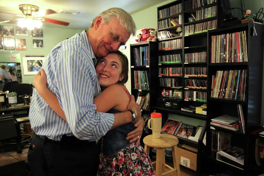 "Voice coach Tom McKinney says goodbye to young country singer Collette Bruhn, 12, after a session on Wednesday, July 31, 2013, in Houston.  Tom McKinney's students include contestants on TV's ""American Idol"" and ""The Sing-Off"" and he knows what it takes to develop one's talents. Photo: Mayra Beltran, Houston Chronicle / © 2013 Houston Chronicle"