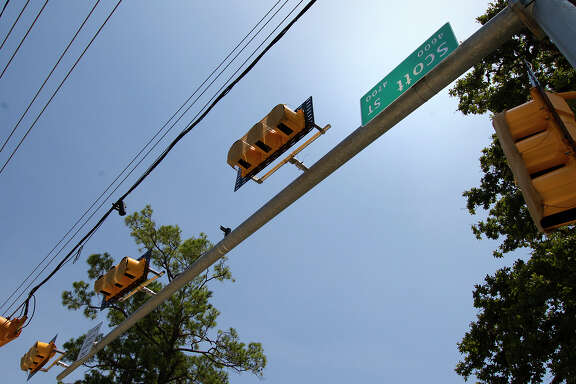 An upside down sign for Scott Street resides at the intersection with Blodgett Street. A city spokesman said the sign mistake will eventually be corrected.