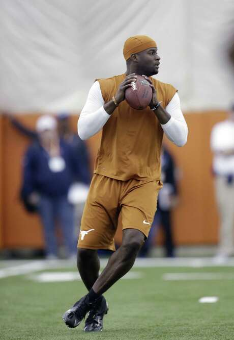 Texas-ex Vince Young will try to resurrect his NFL career with the Packers. Young last played in the NFL with the Bills in 2012. Photo: Eric Gay / Associated Press
