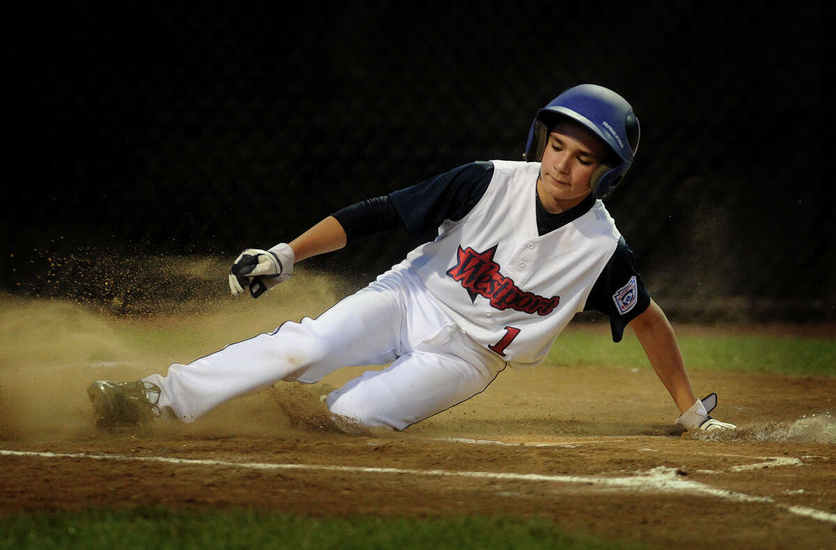 Westport's Chris Drbal scores from third base on a wild pitch during the first inning of their matchup with Rye, New Hampshire in the Little League Baseball Eastern Regional Tournament in Bristol, Conn. on Monday, August 5, 2013.
