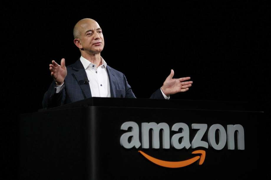 FILE - AUGUST 5, 2013: It was reported that the Washington Post Co. has agreed to sell its flagship newspaper to Amazon.com founder and chief executive Jeff Bezos for $250 million August 5, 2013. SANTA MONICA, CA - SEPTEMBER 6:  Amazon CEO Jeff Bezos unveils new Kindle reading devices at a press conference on September 6, 2012 in Santa Monica, California.  Amazon unveiled the Kindle Paperwhite and the Kindle Fire HD in 7 and 8.9-inch sizes. (Photo by David McNew/Getty Images) Photo: David McNew, Stringer / 2012 Getty Images