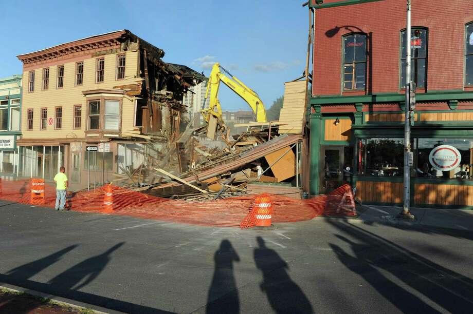Buildings 4,6,8 and 10 on King St. are demolished  Monday afternoon, Aug, 5, 2013 in Troy, N.Y.  (Lori Van Buren / Times Union) Photo: Lori Van Buren / 00023428A
